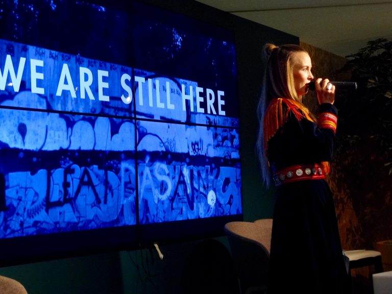 Sami singer Sofia Jannok performs at Arctic Day in the Indigenous Pavilion for COP21 attendees.
